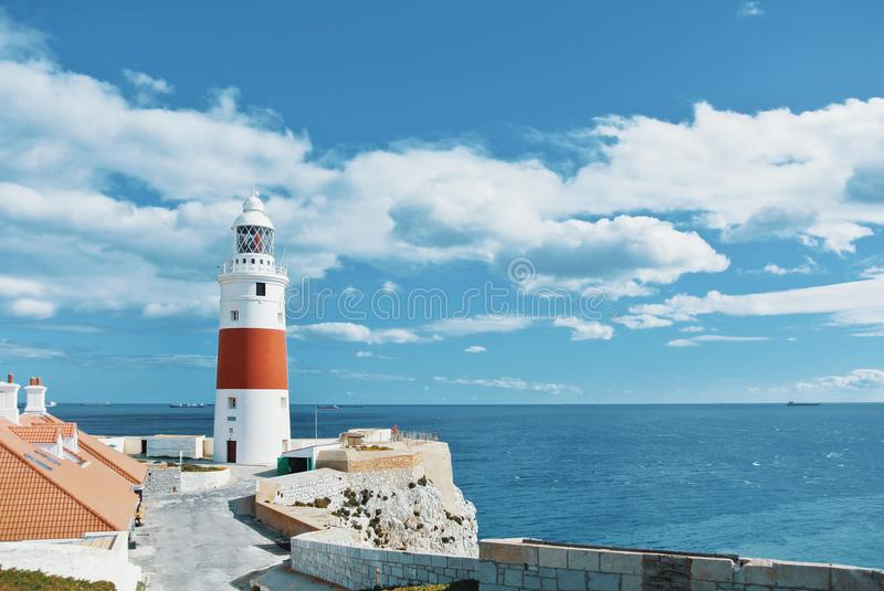A view of beautiful red and white Trinity Lighthouse, orange til stock image