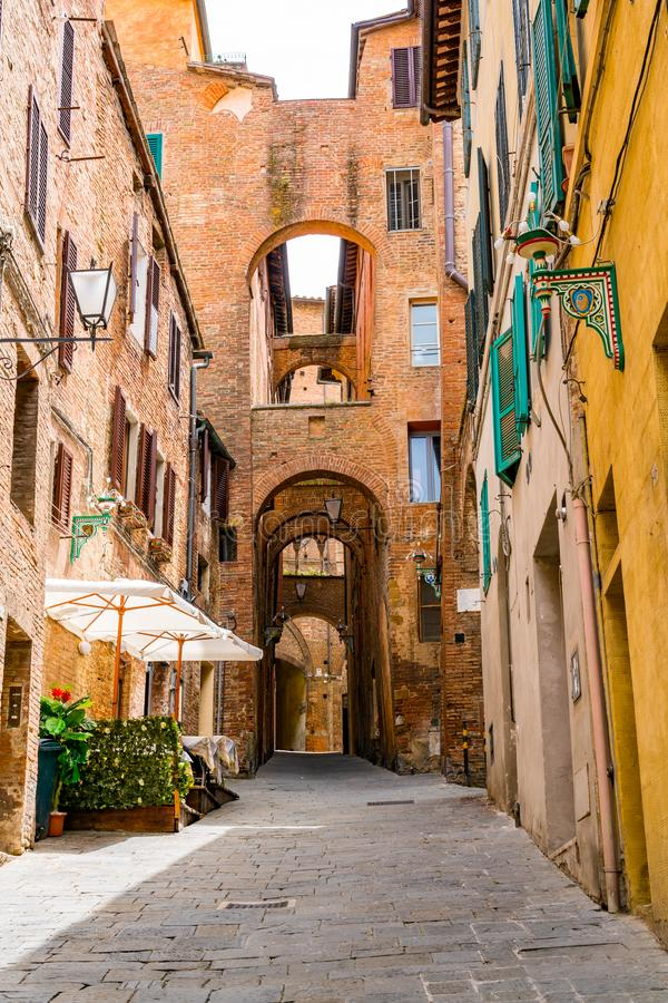 View of the beautiful street archway in the hill top town Siena royalty free stock photo