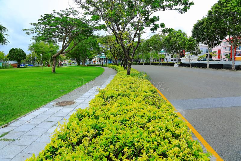 View of beautiful street with green trees and green lawn. Hulhumale Island, Beautiful landmark backgrounds. royalty free stock photo