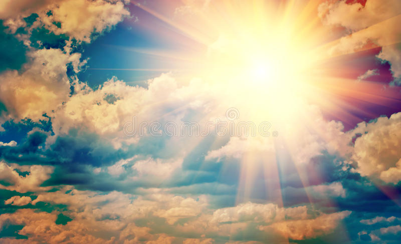 View on beautiful sun in blue cloudy sky instagram stile instagram stile royalty free stock images