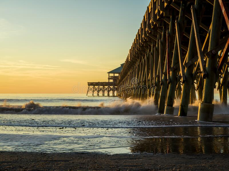 Beautiful sunrise with a pier and amazing colours royalty free stock photos