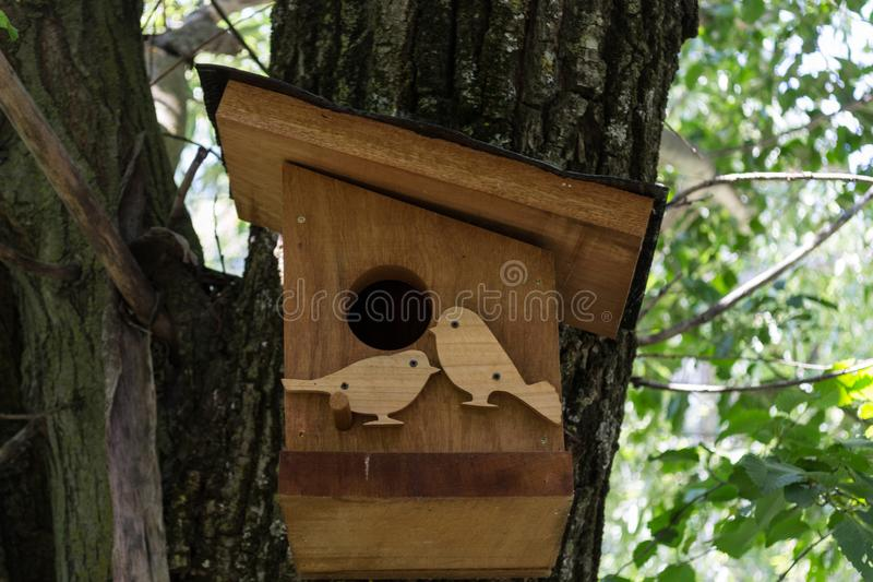 Wooden bird nest box stock photos