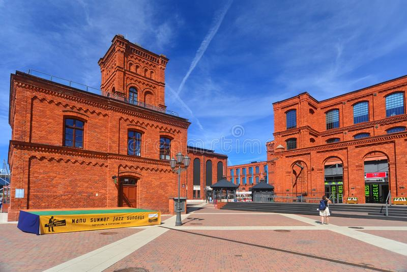Restored old electric plant on factory area in Lodz, Poland. View of an beautifully renovated old electric plant on area of textile factory transformed into royalty free stock image