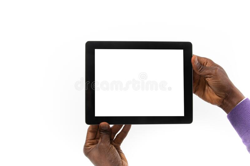 African man holding a tablet computer in his hand stock image
