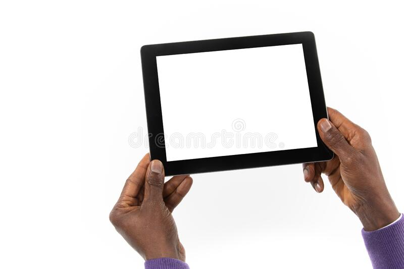 African man holding a tablet computer in his hand royalty free stock photos