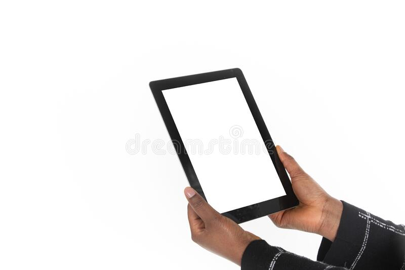 African woman holding a tablet in her hands stock photos