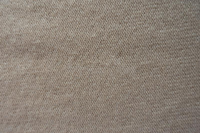 View of beige knit fabric made with reverse stockinette stitch from above royalty free stock photography