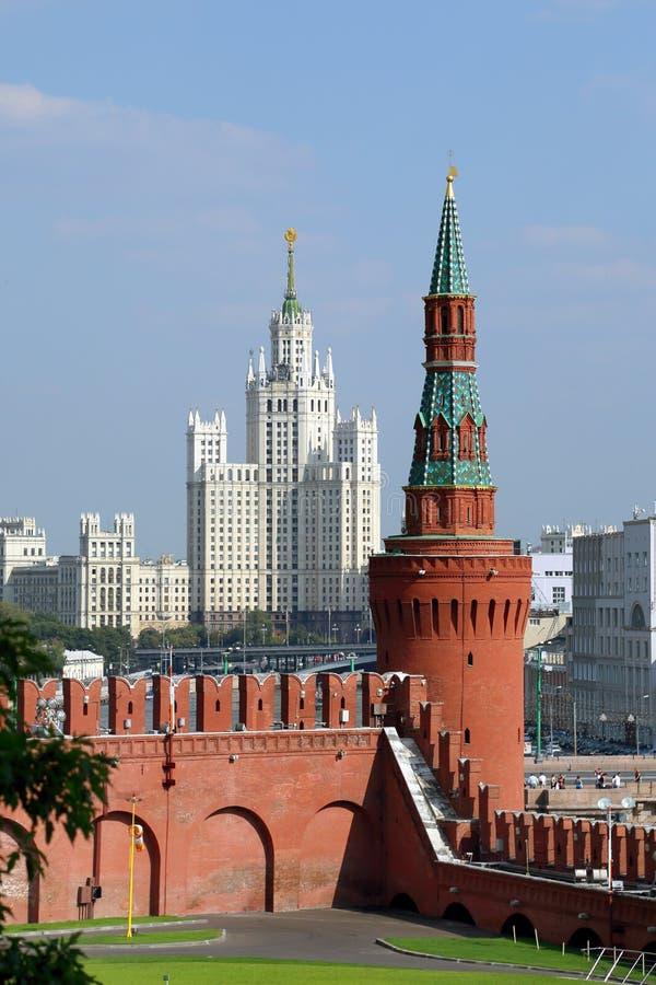 View of the Beklemishevskaya Moskvoretskaya tower and Stalin`s high-rise building on Kotelnicheskaya embankment on a summer day stock images
