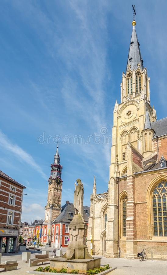 View at the belfry of church of Our Lady in Sint Truiden - Belgium. SINT TRUIDEN,BELGIUM - MAY 17,2018 - View at the belfry of church of Our Lady in Sint Truiden royalty free stock photos