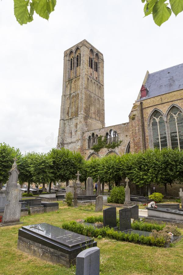 View of the bell tower and the Church of Our Lady in Damme stock images