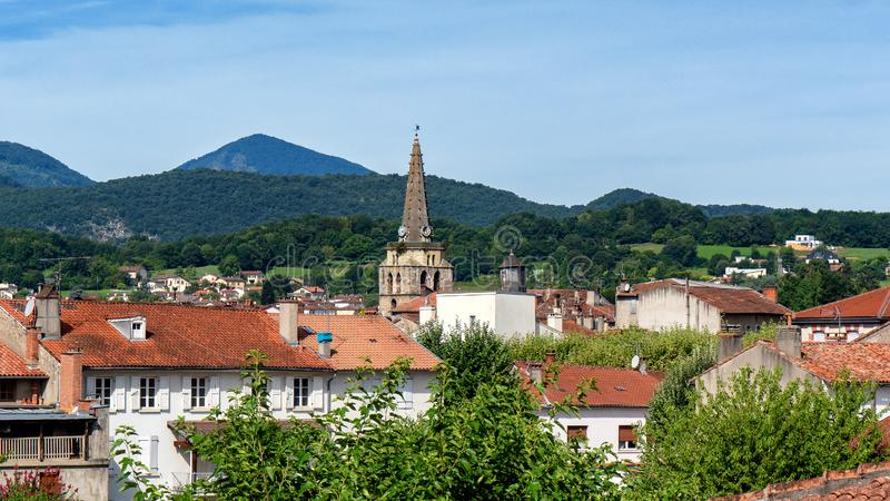 View of the bell tower of the church of Saint Girons in Ariege. A view of the bell tower of the church of Saint Girons in Ariege stock photography