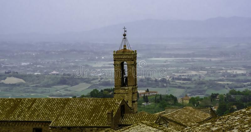 View of a bell tower of the city of Montepulciano, with the Chianti countryside in the background stock images