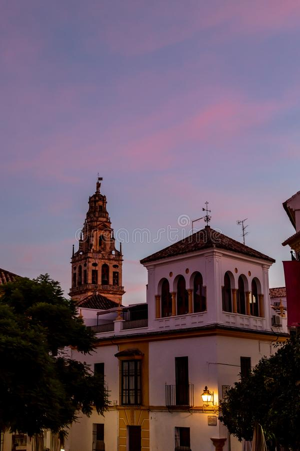 View of the bell tower and former minaret of Mezquita at sunset, Cordoba, Spain stock image
