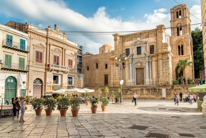 View of Bellini Square with tourists visiting the Santa Maria dell`Ammiraglio Church known as Martorana Church in Palermo. royalty free stock images