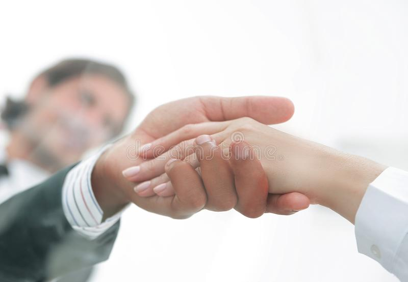 From behind the glass. Handshake of business partners royalty free stock photo