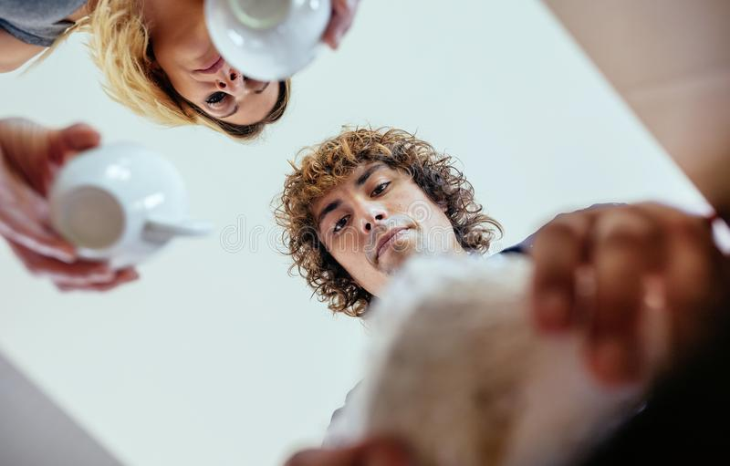 View from below couple unpacking moving boxes stock photos