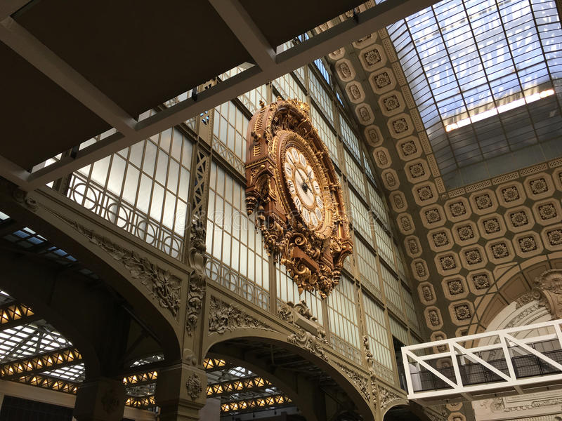 View from below of the gilded clock in Musee d'Orsay, Paris, France. View from below of the Beaux Arts gilded clock and ceiling detail in the Musee d'Orsay stock photography