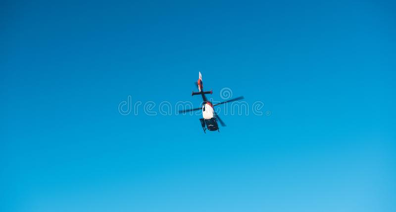View from below of rescue helicopter DRF Luftrettung flying in c stock images