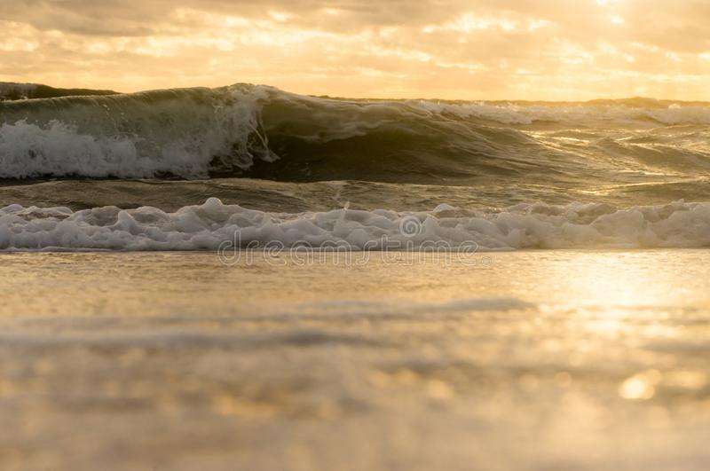 View from below on the storm waves on the shore royalty free stock images