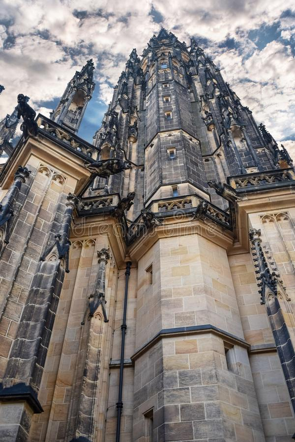 View from below on tall ancient the St. Vitus Cathedral with cloud sky in Prague. View from below on tall ancient the St Vitus Cathedral with cloud sky in Prague stock images