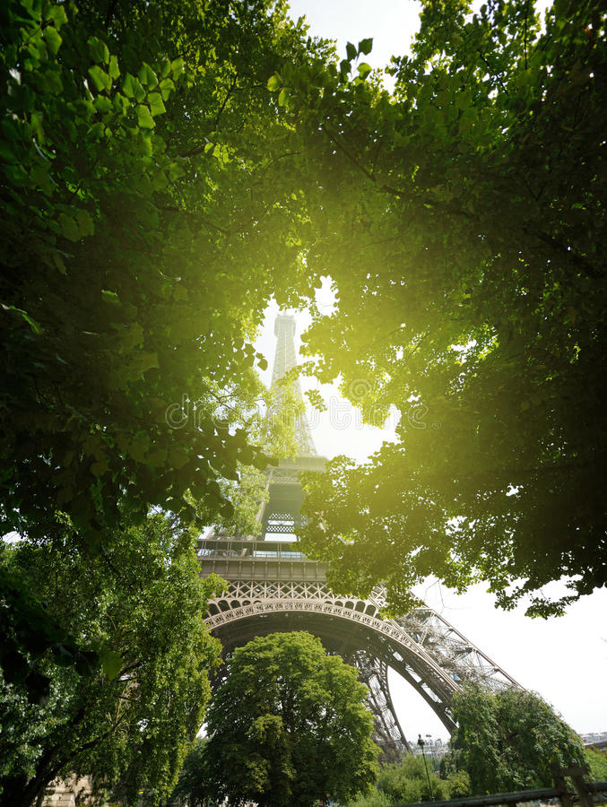 View from below to the Eiffel Tower. Useful file for your brochure, flyer, site or poster about France, its culture and European travel royalty free stock image