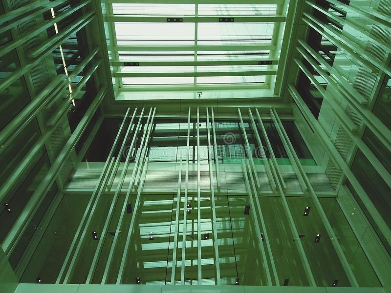 View of below the transparent roof inside building include glass window, steel and Aluminum alloy-Interior design and royalty free stock image