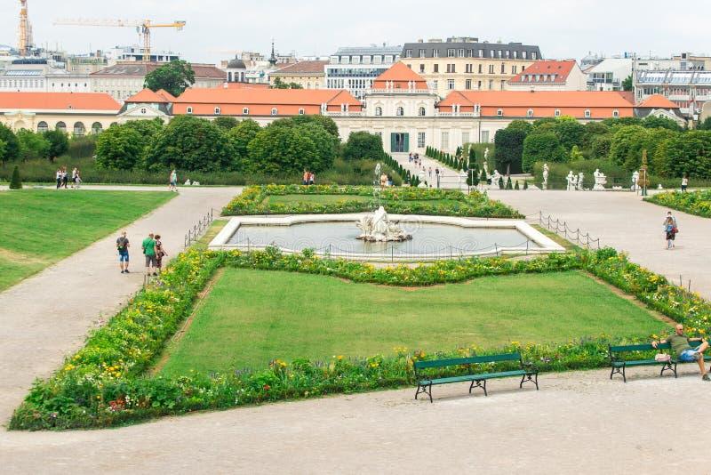 Fountain at Belvedere garden with city - skyline in Vienna , Austria. View at Belvedere gardens with city in Vienna , Austria stock photo