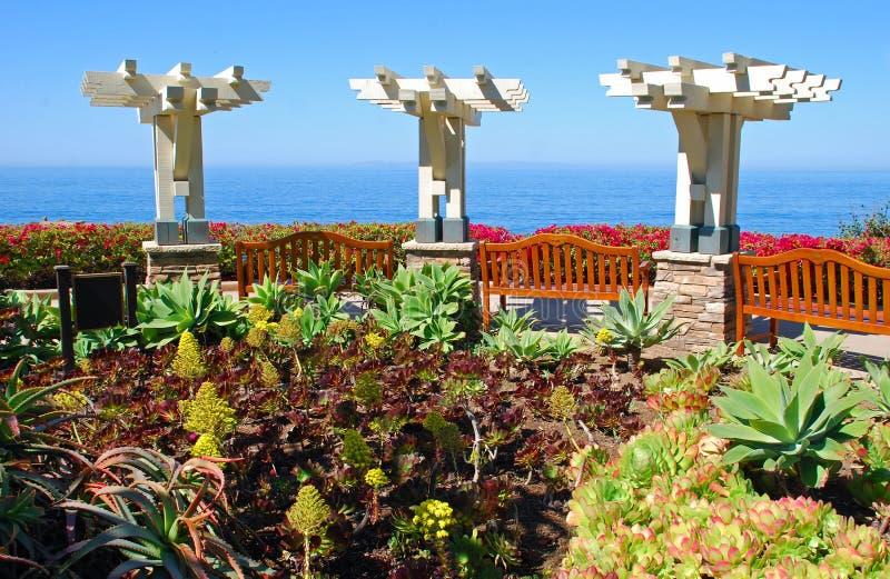 View benches overlooking coastline below Montage Resort stock photography