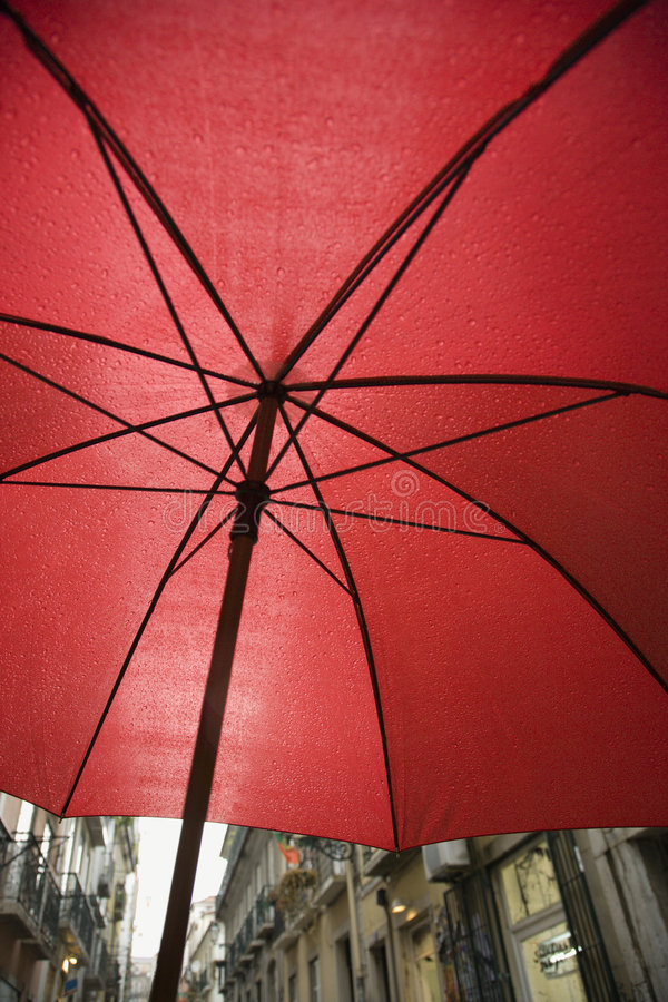 View from beneath red umbrella. stock photography
