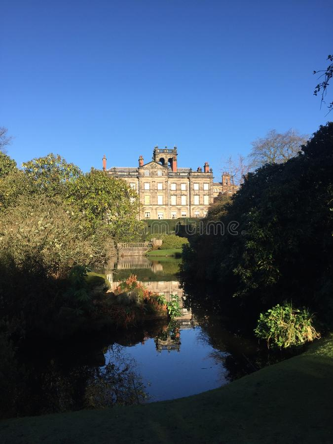 View of Biddulph Grange palace from the bottom of the lake. royalty free stock images
