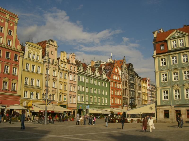 A view from the big beautiful central square in Wroclaw, Poland. Restored central square in Wroclaw with old coloured buildings royalty free stock photos