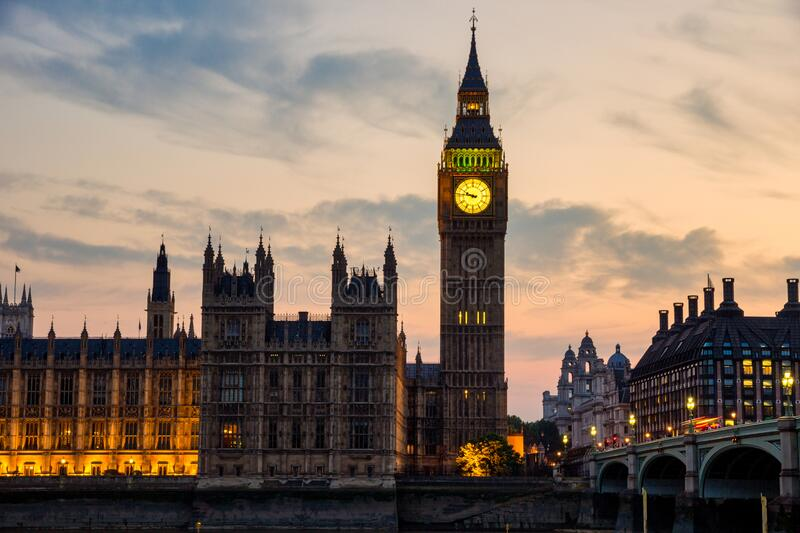 View on the Big Ben and the Palace of Westminster in London at sunset stock images