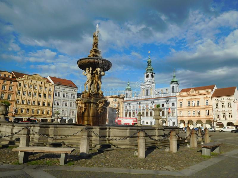 View from the big central square in Ceske Budejovice, Bohemia. A part of the big central square with the fountain and the townhall royalty free stock photos