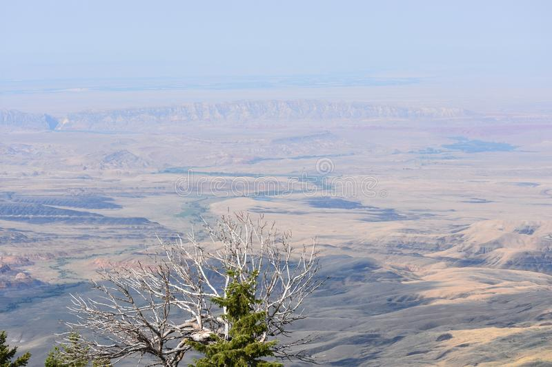 View of Big Horn Basin. A view of the Big Horn Basin, Wyoming from near the top of the Bighorn Mountains. The basin is a high, dry, area, over 100 miles wide. It royalty free stock image