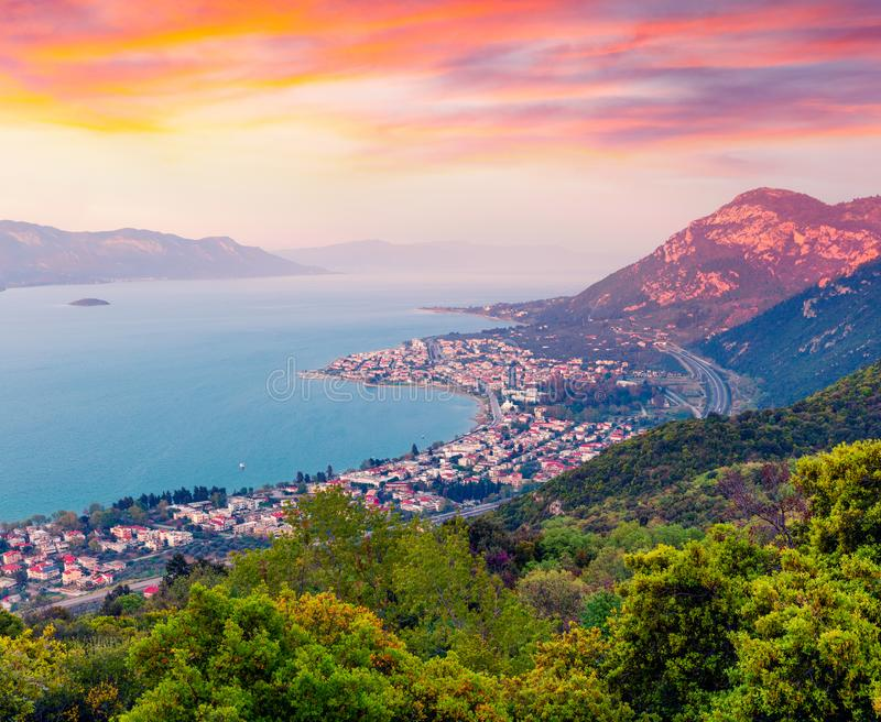 View from the bird`s-eye of Kamena Vourla town in the evening light. Colorful spring cityscape in Greece, Europe. View from the bird`s-eye of Kamena Vourla town stock image