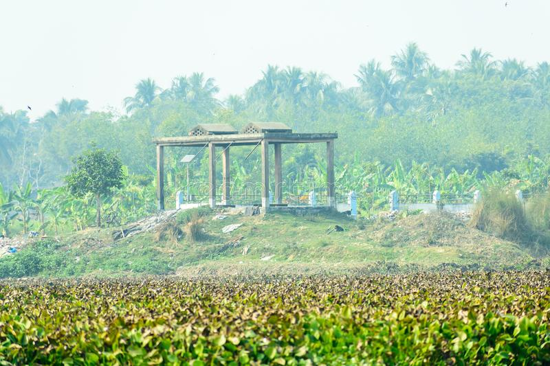 View of Bird watching balcony shade in the wetland of Chupir Chor oxbow lake Damodar and Ganges river with tropical lush of stock photos