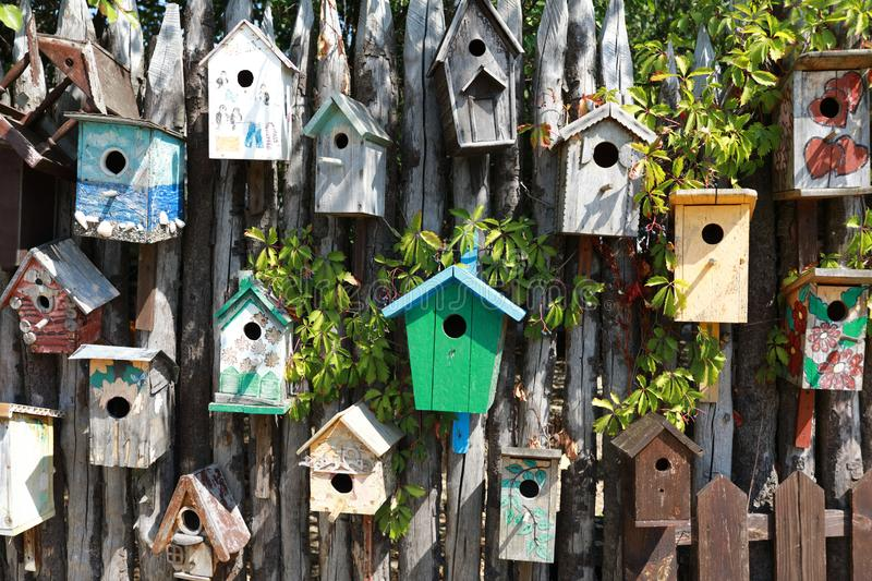 Birdhouses on wooden wall. View of birdhouses on a wooden wall stock photography