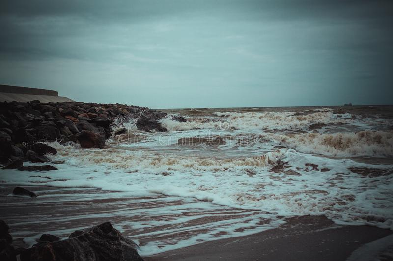 View of the Black Sea during a storm near Odessa 2. Rose waves during a storm in winter, waves break against rocks royalty free stock images