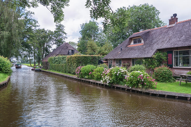View of a blooming garden in front of the house. View of a blooming garden in front of the house of the Dutch town Giethoorn stock photography