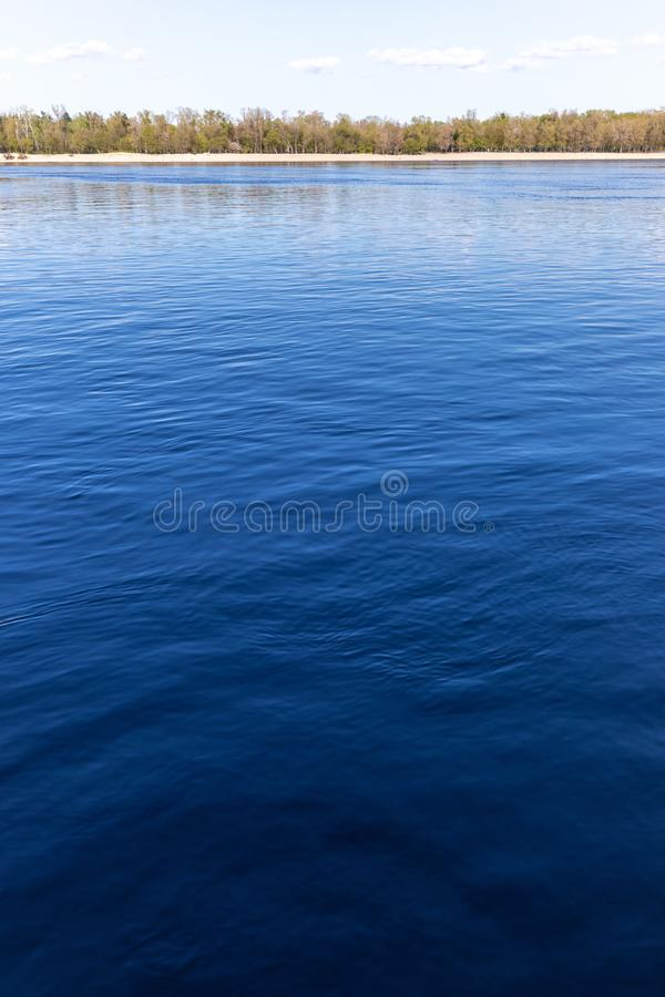 View with blue deep river and horizon line. View with blue river and horizon line royalty free stock images