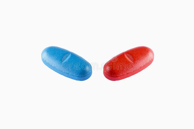 View of a blue and red Pills on White background. Blue and red Pills on White background stock image