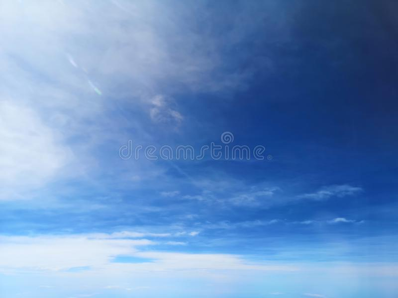 View of the blue sky and cloud on the airplain with nature flaire and fog stock images