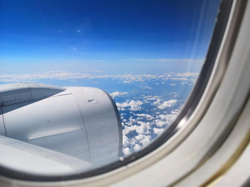View of the blue sky and cloud on the airplain with nature flaire stock images