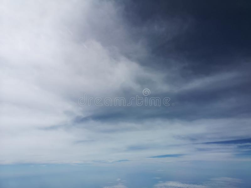 View of the blue sky and cloud on the airplane with nature flaire and fog royalty free stock photography