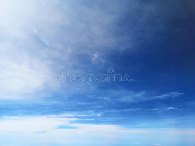 View of the blue sky and cloud on the airplane with nature flaire and fog stock photo