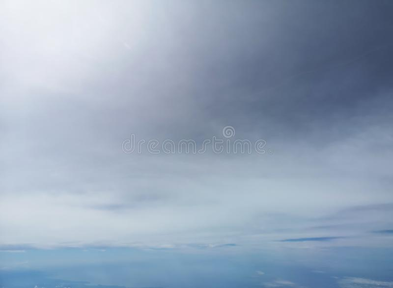View of the blue sky and cloud on the airplane with nature flaire and fog stock image