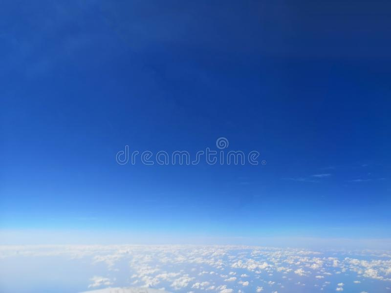 View of the blue sky and cloud on the airplane stock images