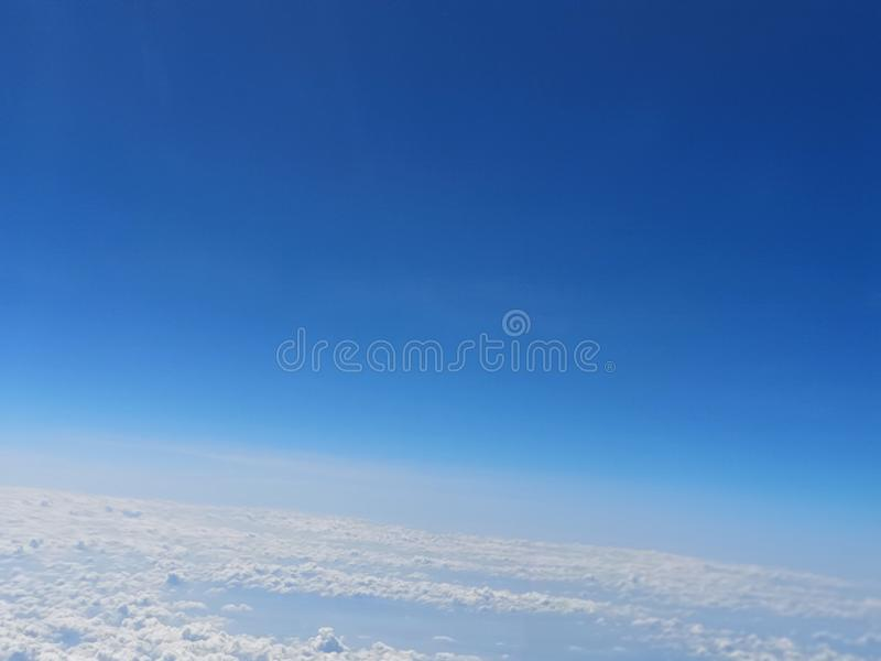 View of the blue sky and cloud on the airplane stock image