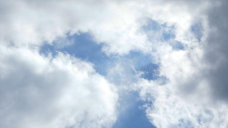 View of blue sky with clouds floating on it. Action. Beauty and immersion in blue of sky with small cumulus clouds. Relaxation, calmness and meditation in royalty free stock photos