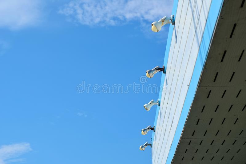 A view of blue sky with white and blue roof. royalty free stock photo